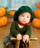 Our clients - Cute baby wearing green hat