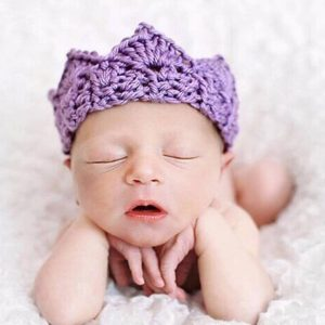 Newborn Photography Prop - Baby wearing purple hat and closing eyes